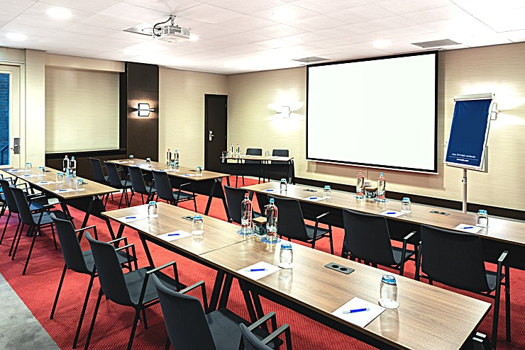 Van Gogh 3 + 4 **Meeting rooms Van Gogh 3 and 4 can be combined into one larger meeting Space. You can host up to 100 people. It's ideal for all types of large meetings, from a network event to a presentation. The total surface is 121m2 and the ceiling height is 2.70m2. The room is equipped with free Wi-Fi, air conditioning, a projector, presentation case and a carpeted floor. Additionally, the room is wheelchair accessible and has lots of daylight.**  **About NH Amsterdam Centre:** The hotel is located in the city center nearby one of the most famous squares of Amsterdam, Leidseplein, and close to restaurants, shops and sightseeing. It's the perfect venue to combine business with leisure. It has 237 spacious hotel rooms and 5 modern meeting Spaces. For some relaxation you can visit the hotel's fitness area or spa. The hotel is easily accessible by public transport. If you plan to travel by car you can park in the surrounding area.  **Feel Safe at NH:** NH Hotel Group launched Feel Safe at NH in collaboration with the SGS. As part of this, 10 protocols have been established for the safety of guests, participants and employees. With this, we guarantee that you can organize your meeting or event in a safe and secure environment. The F&B services are also adapted to the current situation.  The meeting room capacity advertised is the standard one. In case that any COVID restriction or regulation apply, the selected hotel will apply the corresponding restrictions during the quotation process. Based on destination, size and date of the event.