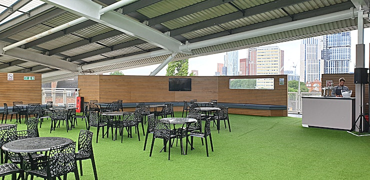 """Corinthian Roof Terrace **The Corinthian Roof Terrace is the Kia Oval's """"hidden gem"""".**  Sitting right at the top of the 1845 Stand, this covered area can hold up to an impressive 600 Guests on an informal basis. There are spectacular views of the pitch on one side and the impressive London skyline on the other side. There are food service stations, bars and even a DJ booth on the Corinthian Roof Terrace, making the area perfect for summer parties or post-conference drinks."""