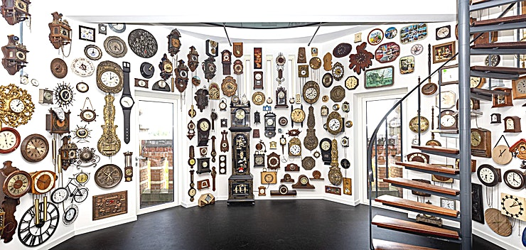 The Clocktower by Erik Kessels **Looking for you next quirky meeting room to impress your Guests?**  Erik Kessels is famous for his work in communication and art, not for his interior design. Therefore, when creating this office for a day, he didn't start with a blueprint of the clock tower, but with an idea. The result, the Clockwork, is a collection of clocks re-appropriated and covering all walls and the ceiling. You can rent it for as long as you want, as long as you keep in mind that with every passing hour, the clocks chime once more. Once your time is up, all of them sound off, resulting in a cacophony that you can only escape by pressing a big red button to leave.