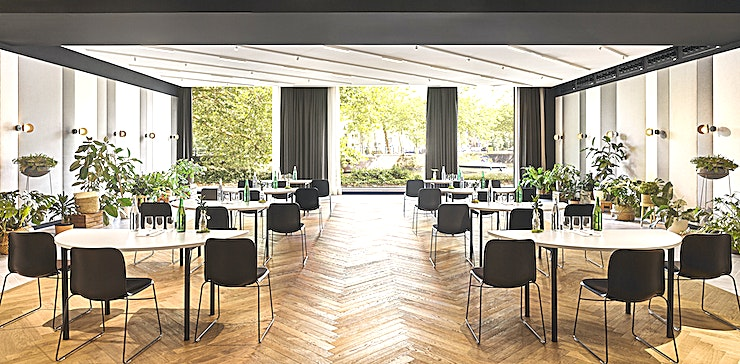Ballroom * The Ballroom at the Hyatt Regency Amsterdam is a large and luxurious space for your next central Amsterdam conference*   Awarded for its refreshing sustainable 'living' décor, five star Hyatt Regency Amsterdam offers spacious botanical inspired guestrooms, relaxing public spaces, a 24H Fitness Centre and Mama Makan Indonesian Restaurant, Bar & Terrace. Located in the city centre, bordering the trendy east neighbourhood, the vibrant hotel seamlessly connects business with pleasure and the city with nature.  The Ballroom is a pillarless 191sqm space for up to 224 guests. Key features include modern oak flooring, minimalist decor and floor-to-ceiling windows that overlook the Singelgracht Canal.
