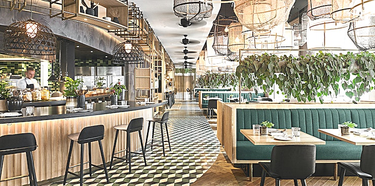 Mama Makan Restaurant  Inspired by the strong roots that bind Holland & Indonesia, hotel restaurant Mama Makan, also a neighbourhood staple, offers guests authentic Indonesian flavours and a warm, lively atmosphere from morning until night.