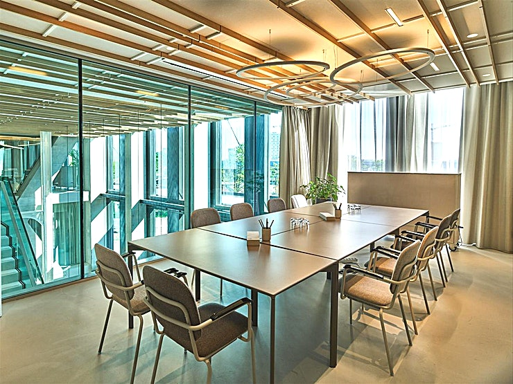 "Anderson An intimate meeting space featuring floor-to-ceiling windows, Bose sound system, 55"" LED screen, and Click-share wireless presentation."