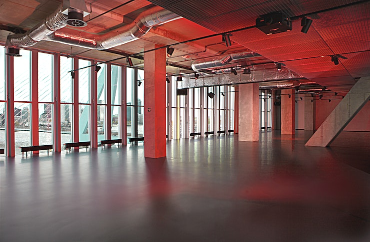 Loft 2 Loft 2 is a great space for an unusual meeting, party, conference (market) and so on. Enjoy exclusive views over The Maas river and Erasmus Bridge. The raw design by Rem Koolhaas/OMA matching the nature of Rotterdam as a city. In this room, all kind of audiovisual needs can be provided.  The total surface is 285m2 big and the ceiling height is 3.40 meters. You can host up to 200 people.  Your attendees can make use of our free Wi-Fi. Furthermore, the room is equipped with air conditioning, a fix projector, high quality furniture, high speed internet, variable light, and WLAN. It is wheelchair accessible, is soundproof and has lots of daylight.  Our dedicated Event Planners are here to assist you in anything and to meet your needs and wishes. Anything is possible. Additionally, we offer facilities for private breakfasts, transport to the city center and airport, hostess service, car and limousine service, translators and photographers. Please make sure that you request these kind of services well in advance.  Feel Safe at NH: NH Hotel Group launched Feel Safe at NH in collaboration with the SGS. As part of this, 10 protocols have been established for the safety of guests, participants and employees. With this, we guarantee that you can organize your meeting or event in all health and safety. Our F&B services are also adapted to the current situation.  The loaded meeting room capacity is the standard one. In case that any COVID restriction or regulation applies to your request, the selected hotel will apply the corresponding restrictions during the quotation process. Based on destination, size and date of the event.