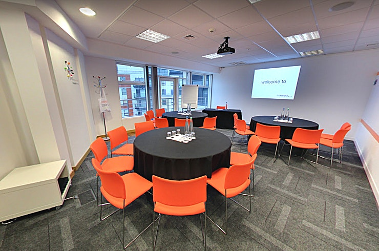 Listen **Situated at the heart of the city, just a hop, skip and jump away from all major transport links: thestudioleeds sits on the 7th and  8th floor offering 11 vibrant event spaces and stunning panoramic views of the city and countryside beyond. Guests also have direct access to a balcony where they can take in the view whilst enjoying some fresh Yorkshire air.**  Listen can be found just off our dedicated breakout area, with separate access to our largest space. Listen can accommodate up to 12 guests boardroom 24 guests theatre style and works equally well when used independently or in conjunction with our largest room.