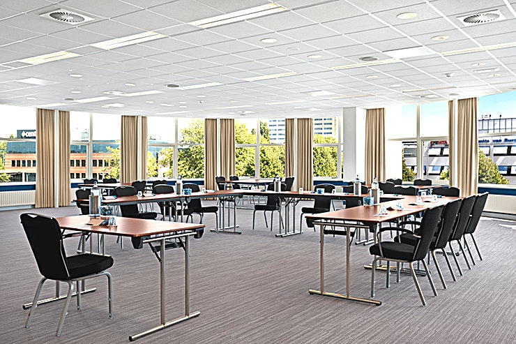 Iris Meeting room Iris is one of the medium sized meeting spaces of NH Zoetermeer. This meeting area is perfectly suitable for a training or presentation. The room is situated on the first floor and you can host up to 40 people.  The surface of this space is 49m2 and the ceiling height is 2.90 meters. The room is equipped with air conditioning, free Wi-Fi and high quality furniture. It has a carpeted floor, variable walls and lots of natural daylight Furthermore, you can make use of our high speed internet for a small compensation.   Special Meeting & Events services: Our Event Planner will work closely together with you in order to plan the right menu for your special event and to meet your needs and wishes. Additionally, we offer you audio-visual equipment rental.   About NH Zoetermeer: The hotel is easy accessible by public transport and by car. It is just a 15 minutes' drive away from the bigger cities The Hague and Rotterdam. There is an on-site parking area, price €10,- per car, per day. In total, there are 14 meeting rooms. On the 7th floor you will find the hotel's gym (free of charge). Our modern Venti Bar is located next to the lobby. Other services that NH Zoetermeer offers are catering services, dry cleaning service, laundry service and a wake-up service. Furthermore, the hotel is wheelchair accessible.   Feel Safe at NH: NH Hotel Group launched Feel Safe at NH in collaboration with the SGS. As part of this, 10 protocols have been established for the safety of guests, participants and employees. With this, we guarantee that you can organize your meeting or event in all health and safety. Our F&B services are also adapted to the current situation.  The loaded meeting room capacity is the standard one. In case that any COVID restriction or regulation applies to your request, the selected hotel will apply the corresponding restrictions during the quotation process. Based on destination, size and date of the event.
