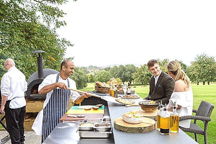 The Berkeley Bar & Terrace **Looking for an outdoor space to relax after your next team away day?**  Hire includes:  - Exclusive use Berkeley Bar and wrap around terrace, complete with speaker system and infra-red heaters - Wood-fired oven and oil-drum BBQs - Breathtaking views overlooking the Cotswolds Hills