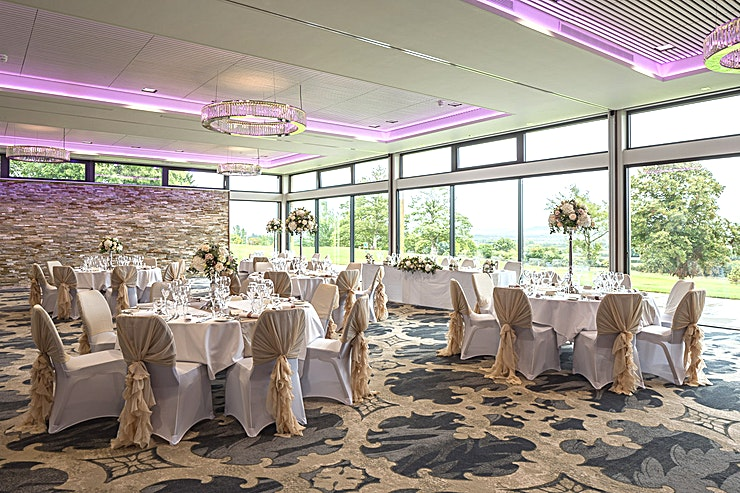 The Burford Suite  **Looking to hire your next team away day Space, with lots of natural daylight?**  Marvelling at panoramic Cotswolds views through floor-to-ceiling glass. Sitting comfortably on 'Allday' designer chairs.   The Cotswolds Suite can be divided into three separate rooms, providing smaller, more intimate Spaces. The middle space is The Burford Suite.  In a nutshell: - Multiscreen video wall with leading-edge speaker system - Soundproof partitions mean a flexible space - Fully air-conditioned surroundings - Hi-speed Wi-Fi thanks to a dedicated leased line - High ceilings and floor to ceiling windows, with electric privacy blinds