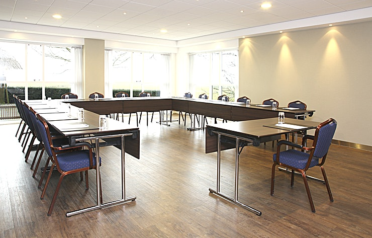 """Veluwemeer Meeting Room """"Veluwemeer"""" is suitable for different types of medium sized meetings. Within this room, you can host up to 60 people.  The surface of this space is 61m2 and the ceiling height is 2.70 me"""