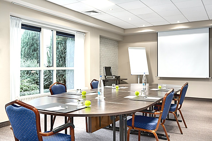 """Naardermeer Meeting Room """"Naardermeer"""" is suitable for different types of small sized meetings. Within this room, you can host up to 10 people.  The surface of this space is 16m2 and the ceiling height is 2.70 me"""