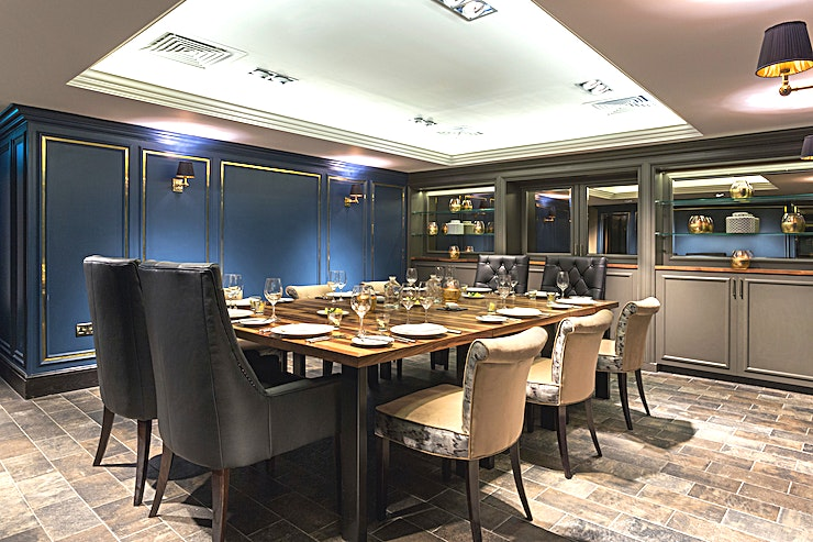 Private Dining Room **Hilton Edinburgh - Queensferry Crossing is sat on 10 acres of parkland. Guests can savour views of the Forth Firth and its three bridges.**   The hotel is 15 miles from Edinburgh, accessible by the A90 or by rail and provides the perfect base for exploring the historic village of North Queensferry and the River Forth, with easy access to Edinburgh City.  Discreetly located beside of the Shore Grill & Fish House, the private dining room is a stunning Space. Featuring striking dark blue panelled walls, beautiful leather chairs and stunning oak tables it offers the perfect backdrop for small meetings or intimate private dinners and celebrations for up to 12 Guests.   CAPACITY: 12  FLOOR AREA (M) 5.4 x 4.4  HEIGHT (M) 2.0  DOOR (M) 2.0 x 0.8