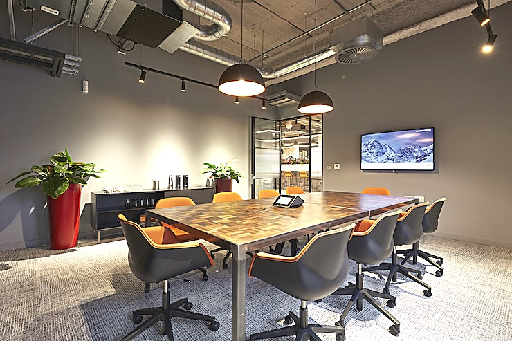 "Meeting Room 1  **This bright and spacious meeting room has super-fast Wi-Fi to suit any meeting or conference.**   The Crestron units and 65"" TV's are available for you to use for presentations, conference and video calls, with Plug and go or wireless options to suit all laptop connections.   The onsite Two Hands Café can fully cater for your meeting, whether that be a power breakfast to get you through the morning, or a sandwich lunch to see you through the rest of the day. These meeting rooms are perfect for a discussion with your board, or a workshop with the flipchart."