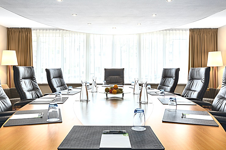 """Boardroom NH Museum Quarter has 1 meeting room at her disposal. This boardroom has a total surface of 47.5m2 and a ceiling height of 2.40m. You can host up to 10 people. The hotel is closely located to the famous """"Leidseplein"""" and RAI Amsterdam.   The meeting room is equipped with air conditioning, free Wi-Fi, a carpeted floor, high speed internet, it has natural daylight and the meeting room is wheelchair accessible.  Feel Safe at NH: NH Hotel Group launched Feel Safe at NH in collaboration with the SGS. As part of this, 10 protocols have been established for the safety of guests, participants and employees. With this, we guarantee that you can organize your meeting or event in all health and safety. Our F&B services are also adapted to the current situation.  The loaded meeting room capacity is the standard one. In case that any COVID"""