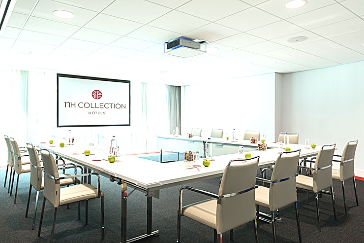 "Utrecht **In meeting Space ""Utrecht"" you can host up to 40 people.**  The total surface is 53m2 and the ceiling height is 2.40 meters. The room is equipped with free Wi-Fi, air conditioning, a projector, variable walls and variable lights. Furthermore, there is lots of natural daylight. This meeting room is ideal for any type of smaller-sized meetings.  **About NH Collection Eindhoven Centre:** the hotel is easily accessible by public transport and by car. Furthermore, the hotel has a restaurant, bar, outdoor terrace and a fitness area.  **Feel Safe at NH:** NH Hotel Group launched Feel Safe at NH in collaboration with the SGS. As part of this, 10 protocols have been established for the safety of guests, participants and employees. With this, NH guarantee that you can organize your meeting or event in a secure and safe environment. The F&B services are also adapted to the current situation.  The loaded meeting room capacity is the standard one. In case that any COVID restriction or regulation applies to your request, the selected hotel will apply the corresponding restrictions during the quotation process. Based on destination, size and date of the event."