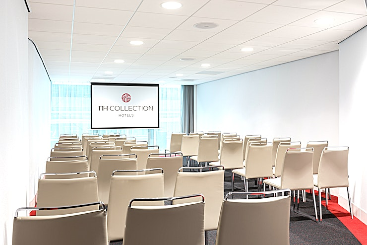 "Amsterdam **In meeting Space ""Amsterdam"" you can host up to 45 people.** The total surface is 54m2 and the ceiling height is 2.40 meters. The room is equipped with free Wi-Fi, air conditioning, a projector, variable walls and variable lights. Furthermore, there is lots of natural daylight. This meeting room is ideal for any type of medium-sized meetings.   **About NH Collection Eindhoven Centre:** the hotel is easily accessible by public transport and by car. Furthermore, the hotel has a restaurant, bar, outdoor terrace and a fitness area.  **Feel Safe at NH:** NH Hotel Group launched Feel Safe at NH in collaboration with the SGS. As part of this, 10 protocols have been established for the safety of guests, participants and employees. With this, NH guarantee that you can organize your meeting or event in a secure and safe environment. The F&B services are also adapted to the current situation.  The loaded meeting room capacity is the standard one. In case that any COVID restriction or regulation applies to your request, the selected hotel will apply the corresponding restrictions during the quotation process. Based on destination, size and date of the event."