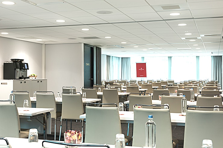 """Utrecht + Eindhoven + Amsterdam **Meeting Spaces """"Utrecht"""", """"Eindhoven"""" and """"Amsterdam"""" can be combined into one larger meeting Space.** In this room you can host up to 160 people. The total surface is 222m2 and the ceiling height is 2.40 meters. The room is equipped with free Wi-Fi, air conditioning, a projector, variable walls and variable lights. Furthermore, there is lots of natural daylight. This meeting room is ideal for any type of larger-sized meetings.  **About NH Collection Eindhoven Centre:** the hotel is easily accessible by public transport and by car. Furthermore, the hotel has a restaurant, bar, outdoor terrace and a fitness area.  **Feel Safe at NH:** NH Hotel Group launched Feel Safe at NH in collaboration with the SGS. As part of this, 10 protocols have been established for the safety of guests, participants and employees. With this, NH guarantee that you can organize your meeting or event in safe and secure environment. The F&B services are also adapted to the current situation.  The loaded meeting room capacity is the standard one. In case that any COVID restriction or regulation applies to your request, the selected hotel will apply the corresponding restrictions during the quotation process. Based on destination, size and date of the event."""