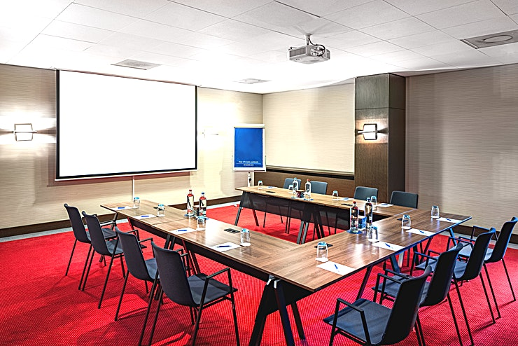 Van Gogh 3 **Meeting room Van Gogh 3 is a modern and well-equipped business room where you can organize small-sized meetings. You can host up to 50 people. It's ideal for all types of small meetings, from a training to a presentation. The total surface is 63m2 and the ceiling height is 2.70m2. The room is equipped with free Wi-Fi, air conditioning, a projector, presentation case and a carpeted floor. Additionally, the room is wheelchair accessible and has lots of daylight.**  **About NH Amsterdam Centre:** The hotel is located in the city center nearby one of the most famous squares of Amsterdam, Leidseplein, and close to restaurants, shops and sightseeing. It's the perfect venue to combine business with leisure. It has 237 spacious hotel rooms and 5 modern meeting Spaces. For some relaxation you can visit the hotel's fitness area or spa. The hotel is easily accessible by public transport. If you plan to travel by car you can park in the surrounding area.  **Feel Safe at NH:** NH Hotel Group launched Feel Safe at NH in collaboration with the SGS. As part of this, 10 protocols have been established for the safety of guests, participants and employees. With this, we guarantee that you can organize your meeting or event in a safe and secure environment. The F&B services are also adapted to the current situation.  The meeting room capacity advertised is the standard one. In case that any COVID restriction or regulation apply, the selected hotel will apply the corresponding restrictions during the quotation process. Based on destination, size and date of the event.