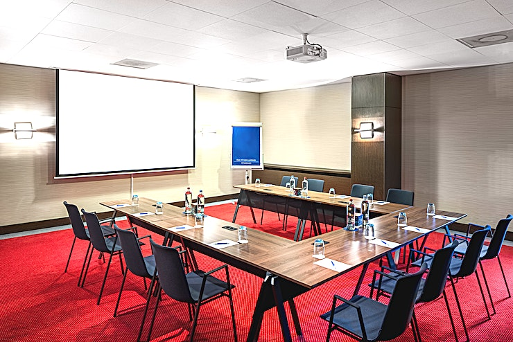 Van Gogh 4 **Meeting room Van Gogh 4 is a modern and well-equipped business room where you can organize small-sized meetings. You can host up to 45 people. It's ideal for all types of small meetings, from a training to a presentation. The total surface is 58m2 and the ceiling height is 2.70m2. The room is equipped with free Wi-Fi, air conditioning, a projector, presentation case and a carpeted floor. Additionally, the room is wheelchair accessible and has lots of daylight.**  **About NH Amsterdam Centre:** The hotel is located in the city center nearby one of the most famous squares of Amsterdam, Leidseplein, and close to restaurants, shops and sightseeing. It's the perfect venue to combine business with leisure. It has 237 spacious hotel rooms and 5 modern meeting Spaces. For some relaxation you can visit the hotel's fitness area or spa. The hotel is easily accessible by public transport. If you plan to travel by car you can park in the surrounding area.  **Feel Safe at NH:** NH Hotel Group launched Feel Safe at NH in collaboration with the SGS. As part of this, 10 protocols have been established for the safety of guests, participants and employees. With this, we guarantee that you can organize your meeting or event in a safe and secure environment. The F&B services are also adapted to the current situation.  The meeting room capacity advertised is the standard one. In case that any COVID restriction or regulation apply, the selected hotel will apply the corresponding restrictions during the quotation process. Based on destination, size and date of the event.
