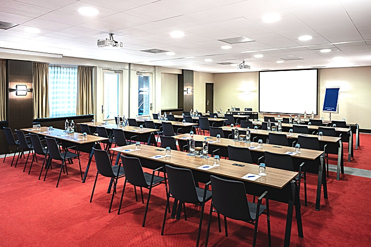 Van Gogh 2 + 3 + 4 **Meeting rooms Van Gogh 2,3 and 4 can be combined into one larger meeting Space. You can host up to 180 people. It's ideal for all types of large meetings, from a network event to a presentation. The total surface is 184m2 and the ceiling height is 2.70m2. The room is equipped with free Wi-Fi, air conditioning, a projector, presentation case and a carpeted floor. Additionally, the room is wheelchair accessible and has lots of daylight.**  **About NH Amsterdam Centre:** The hotel is located in the city center nearby one of the most famous squares of Amsterdam, Leidseplein, and close to restaurants, shops and sightseeing. It's the perfect venue to combine business with leisure. It has 237 spacious hotel rooms and 5 modern meeting Spaces. For some relaxation you can visit the hotel's fitness area or spa. The hotel is easily accessible by public transport. If you plan to travel by car you can park in the surrounding area.  **Feel Safe at NH:** NH Hotel Group launched Feel Safe at NH in collaboration with the SGS. As part of this, 10 protocols have been established for the safety of guests, participants and employees. With this, we guarantee that you can organize your meeting or event in a safe and secure environment. The F&B services are also adapted to the current situation.  The meeting room capacity advertised is the standard one. In case that any COVID restriction or regulation apply, the selected hotel will apply the corresponding restrictions during the quotation process. Based on destination, size and date of the event.