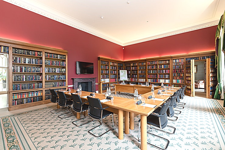 Library, Ditton Manor  **Within the historic manor house is the stunning library.**  Following a 1 Million pound refurbishment, all the Spaces within the manor house have been beautifully restored and the Library is a very unique and special meeting and events room.   Set up in a 19 person U-shape with a television and wireless presentation from phone, tablet or laptop using Clickshare.   The library has a fantastic feature of a hidden doorway within a bookcase that leads to a relaxed lounge for your delegates to enjoy a change of scenery or works perfectly as an office to be on hand throughout the meeting without having to be in the main room.   With natural day light and in room equipment all the meeting rooms at Ditton Manor are ideal for your meetings, training, Christmas parties or private events.   * 16 meeting rooms across the stunning Manor House, modern Southgate Conference Centre and Garden Marquee with 1050 delegate capacity in Theatre setup * Set within 55 acres of tranquil gardens and lawn areas perfect for team building and outdoor events * Excellent location 3 minutes from J5 of M4 and 5 minutes from J15 M25 * Local train stations with direct connections into London Paddington in 16 minutes and Waterloo in 29 minutes * Close to Windsor and 5 miles from Heathrow  * CCTV and onsite security  * Complimentary parking for over 250 vehicles