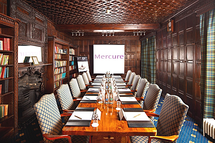 The Library  Holds up to 12 Guests in Boardroom layout Solid oak boardroom table and traditional antique panelling Private dining available Wheelchair accessible Air conditioned 7m x 4m