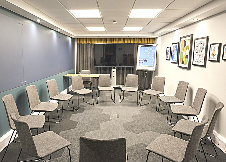 Maybury Bright meeting room with natural daylight that can accommodate up to 12 delegates in theater or boardroom layout.