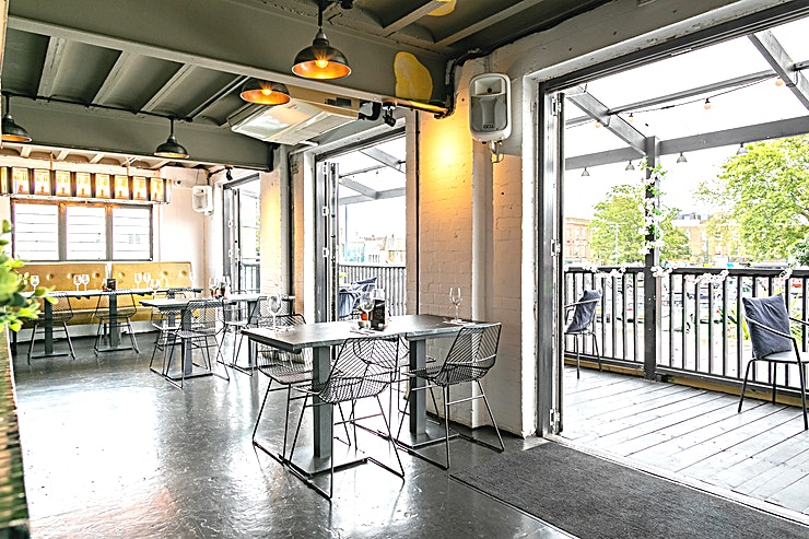 The Mezzanine & Balcony A private lounge area, wrapping around the open kitchen, with a large covered balcony.  The ideal indoor / outdoor setting with bi-folding doors spanning the length of the room and opening up onto a l