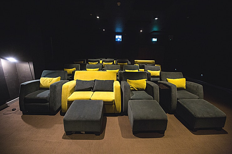 """Private Cinema Purpose-built cinema room with comfortable sofa and armchair seating. Seating up to 20 AV Equipment - 130"""" projection screen; 5.1 surround sound."""