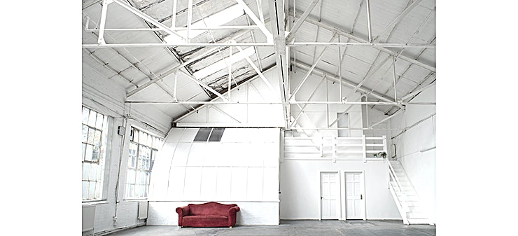 Photographic studio **Hire the photographic studio at Lucerne Studio for your next studio to hire in London.**   Lucerne studio is a photographic and filming studio located in a warehouse built at the end of the 19th century in London. It was home to the known Percy Dalton Peanut Factory which has now been largely converted into artist studios. The location is enlighted by large warehouse style windows and a skylight. The 1,000 sqft and the 5,5 - 7 meters range of height make it suitable for medium productions. The studio provides basic equipment. Additional equipment and catering can be booked on request. Lucerne studio houses also four offices and workplaces.