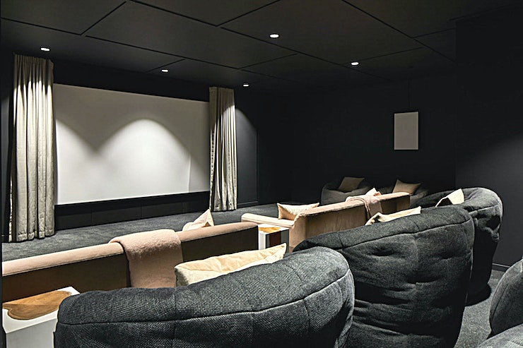 Big Screening Room **The Big Screen cinema room combines large comfy armchairs with squashy beanbags for a very relaxed, intimate feel.**   Within it, 21 guests can sit comfortably to watch films on the large projector with high-quality surround sound. This space works very well for informal team presentations and away days, and can be booked in conjunction with another room.