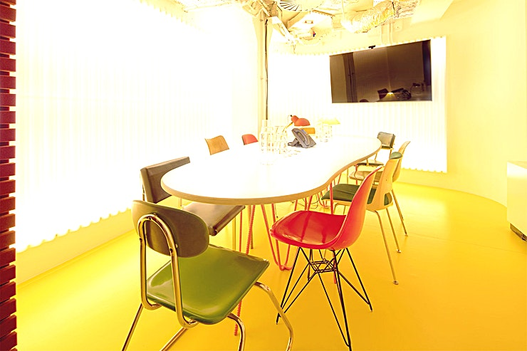 Cano Lasso **Cano Lasso is a modern, state-of-the-art meeting room for hire in east London.**  The venue has decided to think outside the box when designing their meeting rooms, by filling them with colours and various mid-century chairs.   The outcome? Stunning spaces for you to convene and create in, a place to achieve those mind-blowing breakthroughs. Each meeting room is named after innovative thinkers and doers who have inspired Second Home.   All equipped with Wifi, AV system, a phone, and TV screens with inputs for Mac and PC. Complimentary tea and coffee with every booking and the on-site cafe, La Despensa can provide food and drink on request.