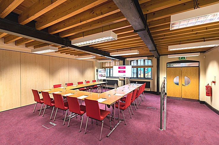 Faraday Room Hire the Faraday Room at IET Austin Court for one of the best options for meeting room hire Birmingham has to offer. Also ideal for a wide range of corporate events.   Overlooking our beautiful landscaped courtyard, this versatile space is easily tailored to suit your needs. From the essential WiFi to lovely views across our Courtyard, the Faraday Room is a practical, attractive venue for any small group.    Whether you need a formal meeting room or space for a creative training session the Faraday room can be adapted accordingly. We can arrange the chairs in rows or u-shape / horseshoe-style layouts to create a boardroom, classroom or theatre. The Faraday Room accommodates 30 guests. It also adjoins the Waterside Room, our popular exhibition venue, which makes it a great overspill area or break-out space if your occasion calls for it.  There are a range of DDR options available ranging from £39.95 - £44.95 pp with a minimum of ten people needed for this Space. If you would like to hire out in the evening from 18.00-21.30 there is a charge of £416 + VAT. Hourly hire is NOT possible - please ignore the rates seen here.