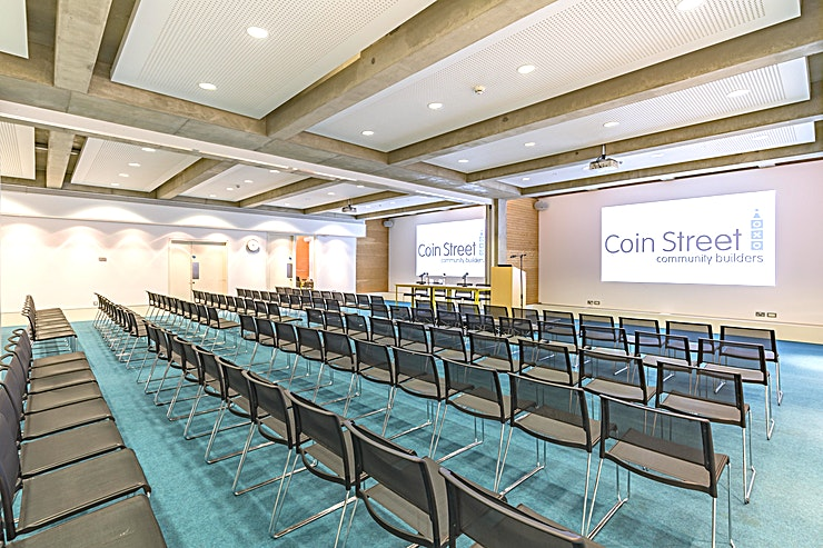 South Bank Suite **The South Bank Suite at Coin Street Conference Centre is a spacious, state-of-the-art conference room for hire in central London.**  Situated a stone's throw from London's South Bank, & just 5 minutes' walk from London Waterloo or Blackfriars station, Coin Street Conference Centre is the ideal location for your next seminar, training event, board meeting, conference or reception.  The South Bank Suite offers flexible solutions for small group workshops through to large conferences. Situated at basement level, the suite benefits from a high ceiling, bright lighting and complete privacy.  The Suite includes a large private foyer, that can be used to serve refreshments, and a third syndicate room, South Bank 3, is attached and can provide seating for up to 20 boardroom style.  By booking your event here, you are investing in their community. Coin Street Community Builders is a not-for-profit social enterprise. Income generated from the hire of their meeting rooms is invested back into their community.