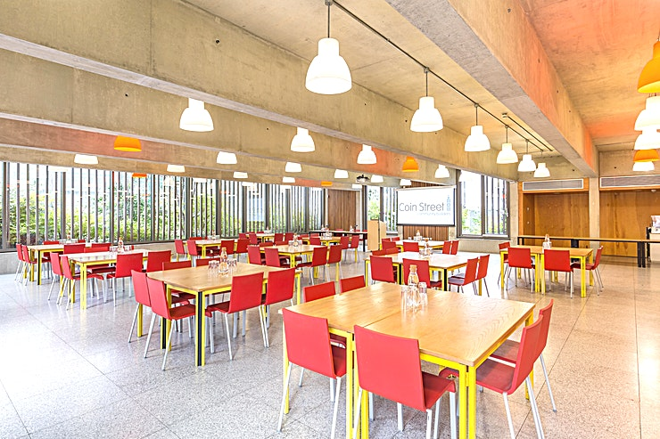 Neighbourhood Room **The Neighbourhood Room at Coin Street Conference Centre is a state-of-the-art, multi-functional event Space for hire in central London.**  Situated a stone's throw from London's South Bank, & just 5 minutes' walk from London Waterloo or Blackfriars station, Coin Street Conference Centre is the ideal location for your next seminar, training event, board meeting, conference or reception.  Located on the ground floor, the Neighbourhood Room is a spacious, flexible and fully accessible space for up to 200 standing.   With natural daylight and access to the adjoining outdoor terrace, the Neighbourhood Room offers comfortable meeting Space for a range of events.  By booking your event here, you are investing in their community. Coin Street Community Builders is a not-for-profit social enterprise. Income generated from the hire of their meeting rooms is invested back into their community.