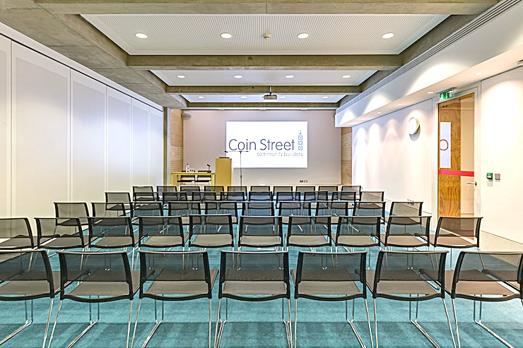 South Bank 1 or 2 **Situated a stone's throw from London's South Bank, & just 5 minutes' walk from London Waterloo or Blackfriars station, Coin Street Conference Centre is the ideal location for your next seminar,  training event, board meeting, conference or reception.**  The versatility of the rooms allows for a range of configurations and an experienced events team will ensure your event runs smoothly.  The South Bank Rooms, South Bank 1 and South Bank 2, can be hired individually or in tandem. With a soundproof wall dividing the two spaces. The privacy allows for a perfect Space for a more intimate meeting, training workshop, seminar or away day.  The Centre is a fully accessible venue; with in-built hearing loops, lift access to each floor, a 250 Space car park and large print signposting throughout the building.   By booking your event here, you are investing in their community. Coin Street Community Builders is a not-for-profit social enterprise. Income generated from the hire of their meeting rooms is invested back into their community.