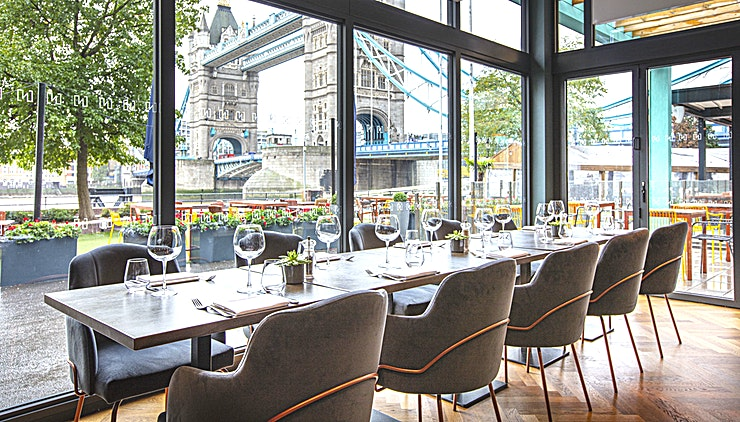 Vicinity London **A laidback riverfront bar and eatery overlooking the London neighbourhood.**   Pay homage to one of the world's most spectacular skylines. From a busy lunch setting all the way through to a chille
