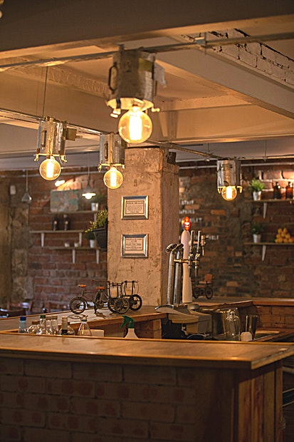 "Main Area **A basement unit with exposed brick and stone walls creating a perfect ""empty canvas"" look giving an opportunity to express your ideas by designing the place to your liking.**