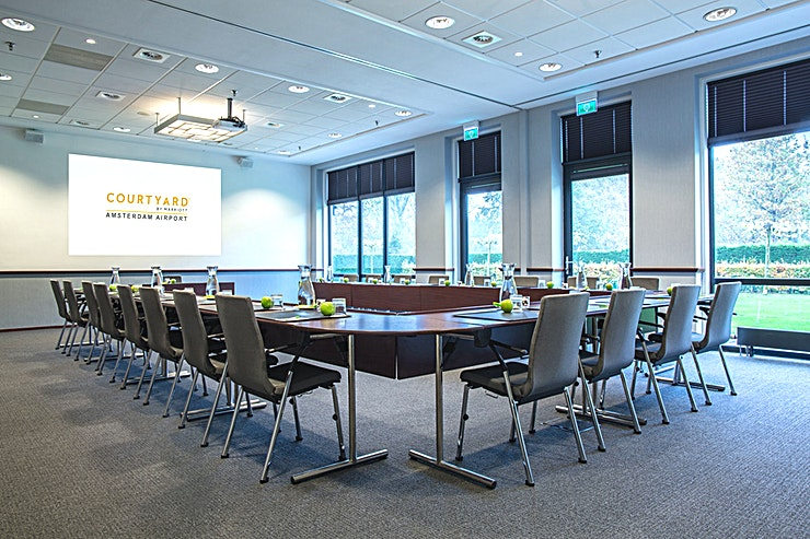 Meeting Room 5 As well as business as leisure guests, experience in the 4-star hotel a luxurious ambiance best described as casual, comfortable and efficient. Courtyard hotel has 260 modern rooms equipped with air conditioning, complimentary Wi-Fi, Smart Tv's with Chromecast streaming (for wireless streaming) and spacious bathrooms. Furthermore there are 10 multipurpose meeting rooms, among which an auditorium with a capacity till 330 persons. Each meeting room is equipped with whitewalls, Click share system and Marriott's Meeting Service App.