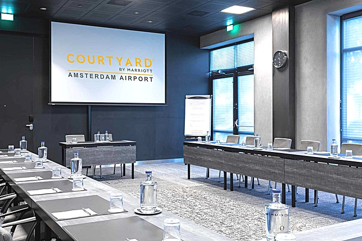 Meeting Room 9 **Meeting Room 9 at Courtyard by Marriott Amsterdam Airport is a stylish meeting room for hire in Amsterdam.**  As well as business as leisure guests, experience in the 4-star hotel a luxurious ambience best described as casual, comfortable and efficient. Courtyard hotel has 260 modern rooms equipped with air conditioning, complimentary Wi-Fi, Smart TVs with Chromecast streaming (for wireless streaming) and spacious bathrooms.   Furthermore, there are 10 multipurpose meeting rooms, among which an auditorium with capacity up to 330 persons.   Each meeting room is equipped with whitewall, Click Share system and Marriott's Service App.