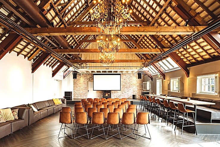 The Farmhouse **The Farmhouse is a multifunctional Space for events up to 150 people. It features a large fireplace and has direct access to the terrace.**