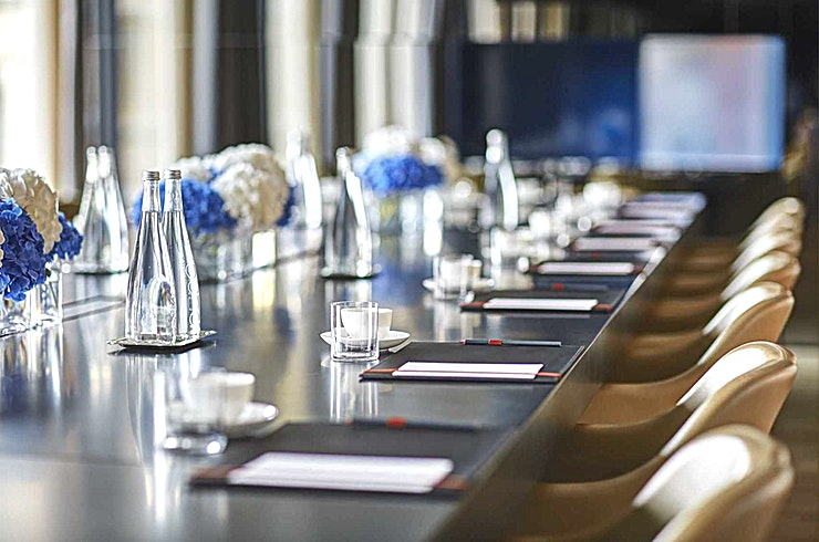 The Blue Room **The Blue Room is a 50 sqm area denoted by its intimate atmosphere and views out onto the courtyard.**   It has a maximum capacity of 26 Guests in a fixed boardroom and dinner set-up and is the only space that offers both LCD screen and a built-in beamer.