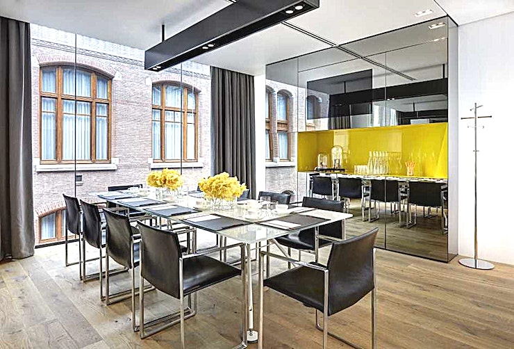 The Yellow Room **The Yellow Room has 20 sqm of space and a maximum capacity of ten guests in a fixed boardroom and dinner set-up.**   The Space has views into the atrium of the hotel and offers a built-in LCD scre