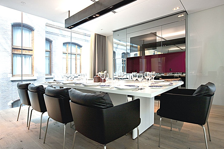 The Red Room **The Red Room has 20 sqm of Space and a maximum capacity of ten guests in a fixed boardroom and dinner set-up.**   The atrium can be seen through glass windows and the Red Room also features a buil