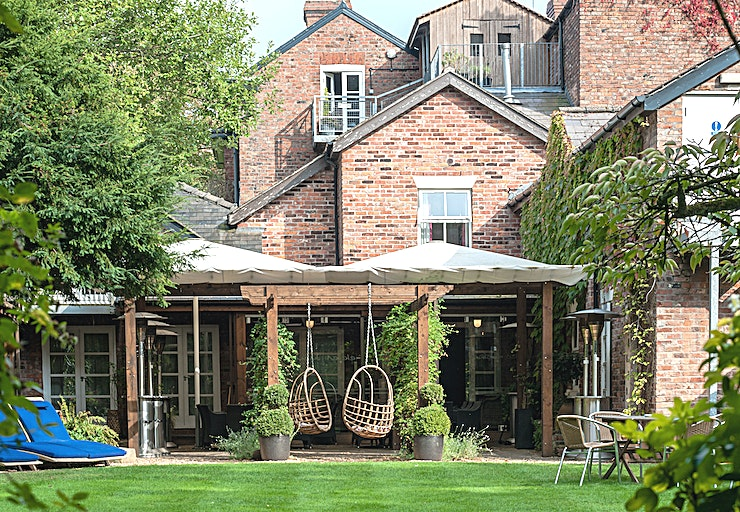 Garden Lounge & Walled Terrace **All or part of Eleven Didsbury Park can be hired exclusively from residential corporate meetings and events, christenings, baby showers, family parties to wedding celebrations.**  The Walled Victo