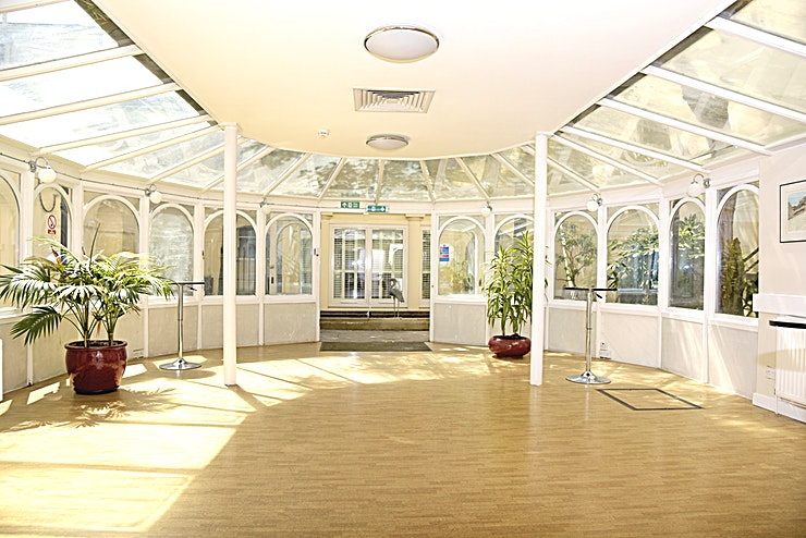 Garden Room **The Garden Room at SCI Belgravia is a stunning event venue for hire in London.**  The Garden Room is a light, modern Space with a conservatory and direct access to our private garden making it the p