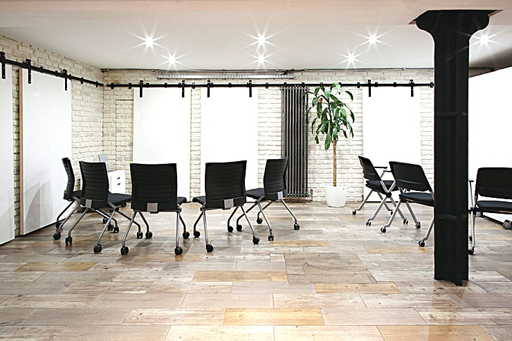 Studio Meeting Room **An architecturally-designed space located near Old Street Station, the IA Studio is comprised of a 30sqm ground floor and a well-lit 60sqm basement.**    The Space is set over two floors with many large work walls for planning, writing and creative thinking as well as breakout sessions.  A relaxed style working Space, ideal for team meetings or away days, workshops and training sessions or for just getting work done!