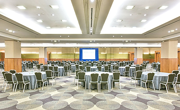 Arora Suite **Located on – 2 to the ground level, the room can be subdivided into 7 smaller rooms plus a corridor and also has a patch facility panel to patch between all sections of the suite.**  Full event production is available from the in-house AV partner (prices available on request).  The room can be fully customized with a choice of 12 pre-set colour settings. The Arora Foyer is used for breaks (400sqm) and is ideal for pre-dinner drinks and refreshment breaks with its dedicated bar.   It also contains multimedia screens, a cloakroom and two event organisers offices. The Arora suite also provides vehicular access from the loading bay and one green room for performing artist.