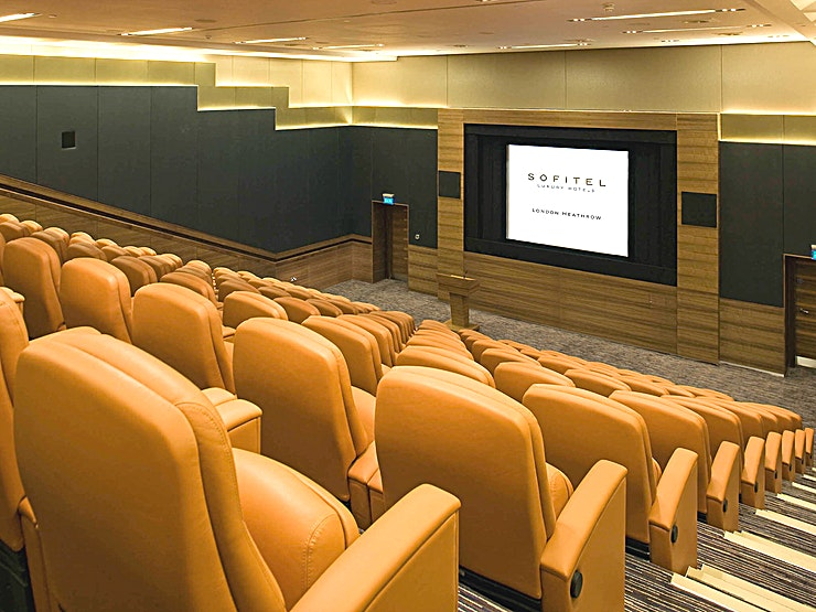 Arora Theatre **This purpose-built tiered theatre can accommodate 117 delegates in theatre or classroom style and is located on the lower ground level.**  The Arora Theatre has in-built audio-visual equipment. It