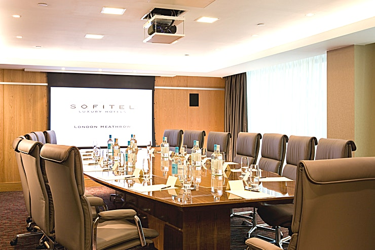 Tokyo **Tokyo is located on the lower ground level of the Sofitel London Heathrow, the room includes inbuilt AV equipment (chargeable) including a screen.**   On-site AV partner can assist with any other requirements. High-Speed Internet Access is available.  The meeting room is equipped with in-room tea/coffee station and boasts of Hugo Boss chairs.
