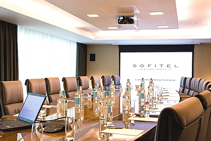 Athens **Athens at Sofitel London Heathrow is located on the lower ground level, the room includes inbuilt AV equipment (chargeable) including a screen, ceiling-mounted projector and touch screen remote control.**  On-site AV partner can assist with any other requirements (chargeable) and high-speed internet access is available.   The meeting room is equipped with in-room tea/coffee station and boasts Hugo Boss chairs.
