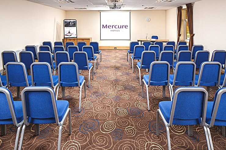 Pine Suite **The Pine Suite at Mercure Leeds Parkway Hotel is a versatile event Space for hire in Leeds.**  The Pine Suite is located on the lower ground floor of the conference centre, adjacent to a breakout area which is the ideal space for registration or refreshments to be served.   The room is pillar-free with a built-in LCD projector and screen, natural daylight and air conditioning.
